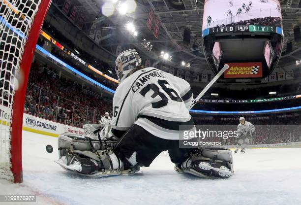 Drew Doughty of the Los Angeles Kings goes down in the crease to make a glove save during an NHL game against the Carolina Hurricanes on January 11...