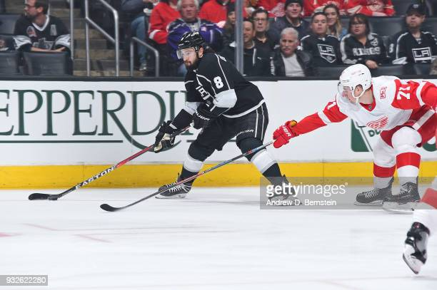 Drew Doughty of the Los Angeles Kings handles the puck against Dylan Larkin of the Detroit Red Wings at STAPLES Center on March 15 2018 in Los...