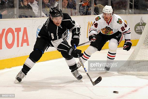 Drew Doughty of the Los Angeles Kings handles the puck as Martin Havlat of the Chicago Blackhawks follows on the play on January 29 2009 at Staples...