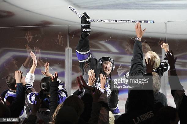 Drew Doughty of the Los Angeles Kings hands his stick over the glass to a fan after being named First Star of the game against the Ottawa Senators on...