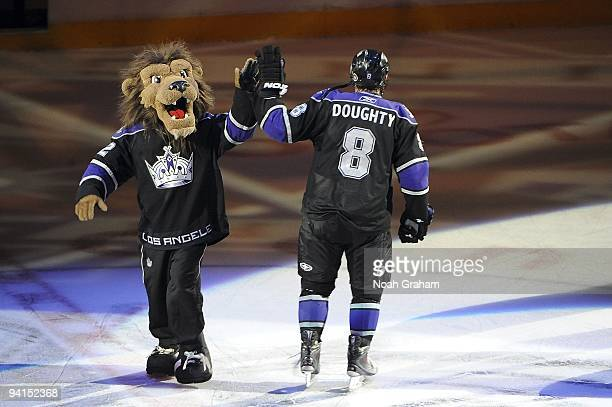 Drew Doughty of the Los Angeles Kings high fives Kings mascot Bailey as he is introduced as the star of the game against the Ottawa Senators during...
