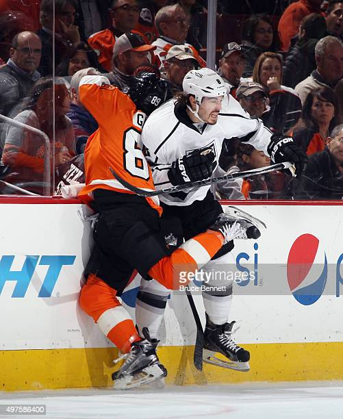 Drew Doughty of the Los Angeles Kings hits Sam Gagner of the Philadelphia Flyers into the boards during the first period at the Wells Fargo Center on...