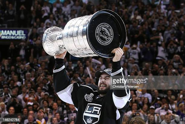 Drew Doughty of the Los Angeles Kings hoists the Stanley Cup in celebration after defeating the New Jersey Devils in Game Six of the 2012 Stanley Cup...