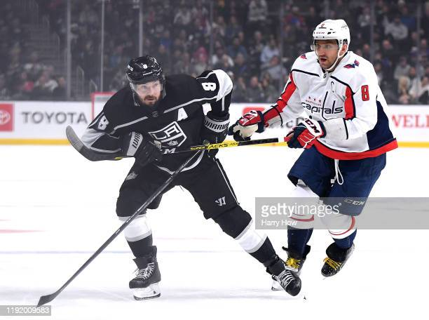 Drew Doughty of the Los Angeles Kings holds on to the stick of Alex Ovechkin of the Washington Capitals during the second period at Staples Center on...