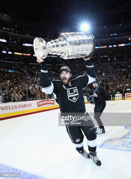 Drew Doughty of the Los Angeles Kings holds up the Stanley Cup after the Kings defeated the New Jersey Devils 6-1 to win the Stanley Cup series 4-2...