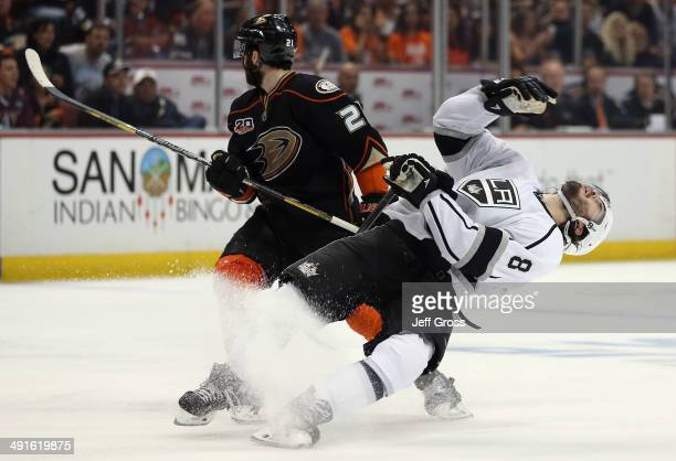 Drew Doughty of the Los Angeles Kings is elbowed by Kyle Palmieri of the Anaheim Ducks in the third period of Game Seven of the Second Round of the...