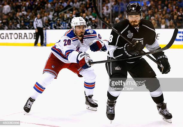 Drew Doughty of the Los Angeles Kings is pressured by Chris Kreider of the New York Rangers during the third period of Game One of the 2014 Stanley...