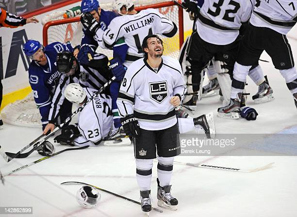Drew Doughty of the Los Angeles Kings laughs as he watches the brawl behind him on the jumbotron during the game against the Vancouver Canucks in...