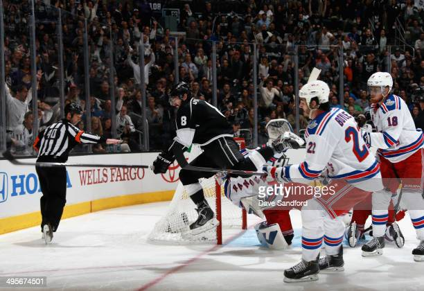 Drew Doughty of the Los Angeles Kings leaps after scoring against the New York Rangers in the second period of Game One of the 2014 Stanley Cup Final...