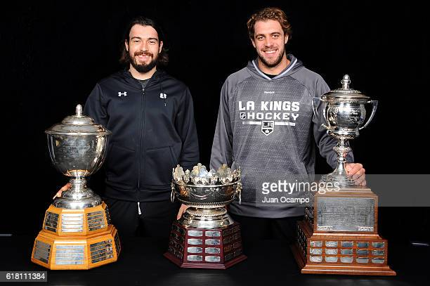 Drew Doughty of the Los Angeles Kings left poses with the Norris Trophy as Anze Kopitar poses with the Frank J Selke Trophy center and the Lady Byng...