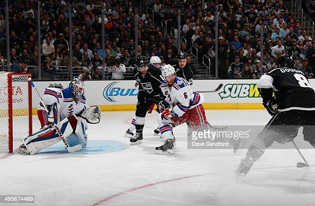 Drew Doughty of the Los Angeles Kings lines up a shot on goaltender Henrik Lundqvist of the New York Rangers to score in the second period of Game...