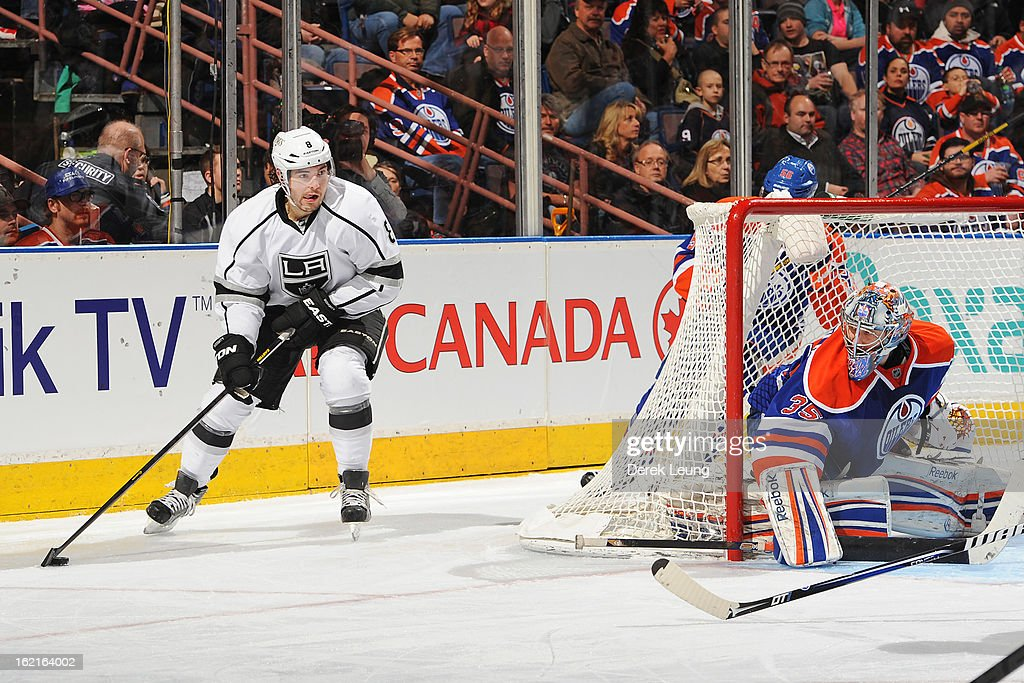 Drew Doughty #8 of the Los Angeles Kings looks for an open teammate while Nikolai Khabibulin #35 of the Edmonton Oilers defends net during an NHL game at Rexall Place on February 19, 2013 in Edmonton, Alberta, Canada. The Los Angeles Kings won 3-1.