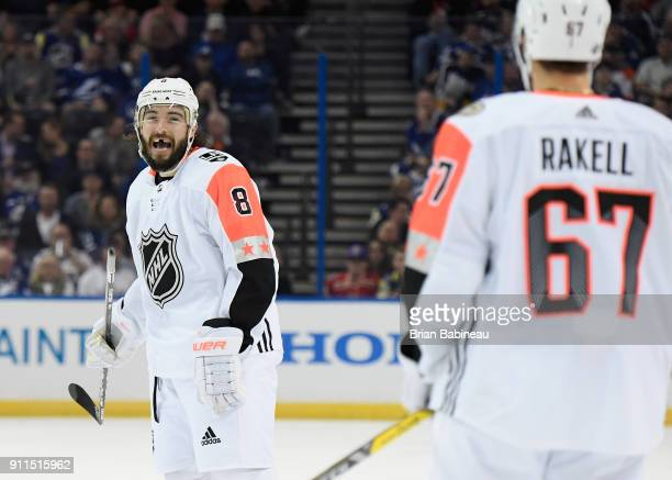 Drew Doughty of the Los Angeles Kings looks to Rickard Rakell of the Anaheim Ducks as Dougty reacts during the 2018 Honda NHL AllStar Game between...