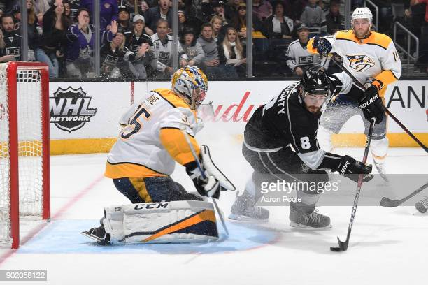 Drew Doughty of the Los Angeles Kings looks to shoot the puck against Pekka Rinne of the Nashville Predators at STAPLES Center on January 6 2018 in...