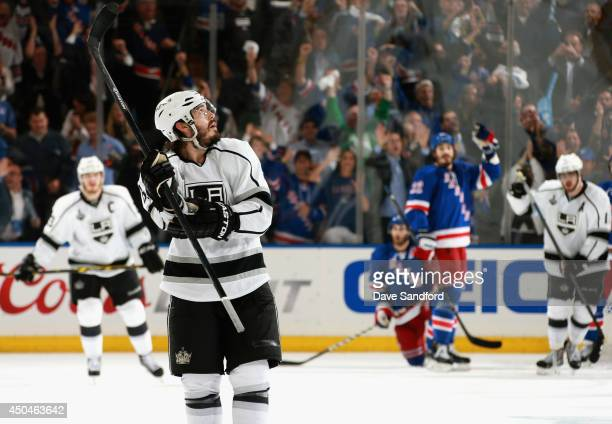 Drew Doughty of the Los Angeles Kings looks up at the clock at the end of the third period of Game Four of the 2014 Stanley Cup Final against the New...