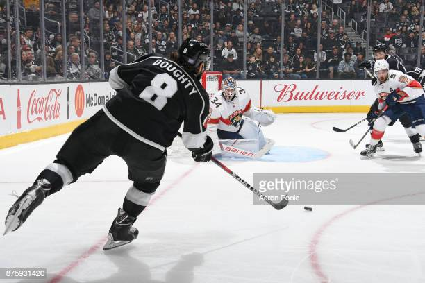 Drew Doughty of the Los Angeles Kings passes the puck against James Reimer and Aaron Ekblad of the Florida Panthers at STAPLES Center on November 18...