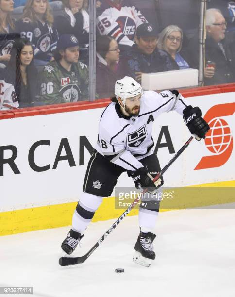 Drew Doughty of the Los Angeles Kings plays the puck up the ice during first period action against the Winnipeg Jets at the Bell MTS Place on...