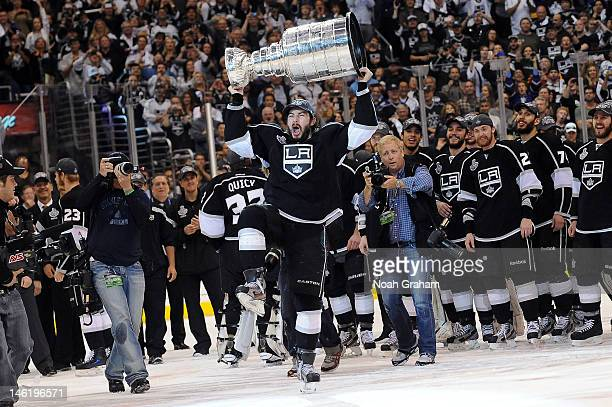 Drew Doughty of the Los Angeles Kings raises the Stanley Cup after defeating the New Jersey Devils after Game Six of the 2012 Stanley Cup Final at...