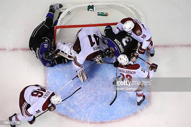 Drew Doughty of the Los Angeles Kings scores the winning goal in overtime against the Phoenix Coyotes at Staples Center on January 5, 2012 in Los...