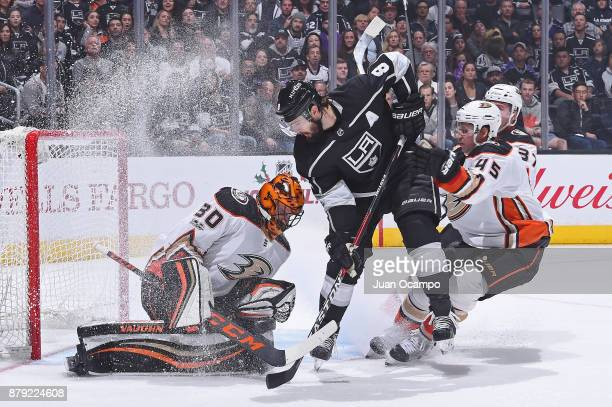 Drew Doughty of the Los Angeles Kings shoots the puck against Ryan Miller of the Anaheim Ducks at STAPLES Center on November 25 2017 in Los Angeles...