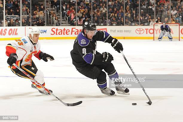 Drew Doughty of the Los Angeles Kings skates against Eric Nystrom of the Calgary Flames at Staples Center on November 21, 2009 in Los Angeles,...