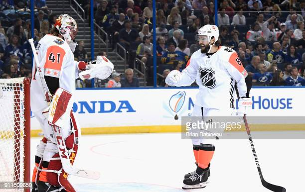 Drew Doughty of the Los Angeles Kings skates over to celebrate with goaltender Mike Smith of the Calgary Flames during the 2018 Honda NHL AllStar...