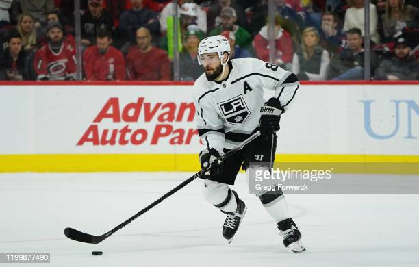 Drew Doughty of the Los Angeles Kings skates with the puck during an NHL game against the Carolina Hurricanes on January 11 2020 at PNC Arena in...