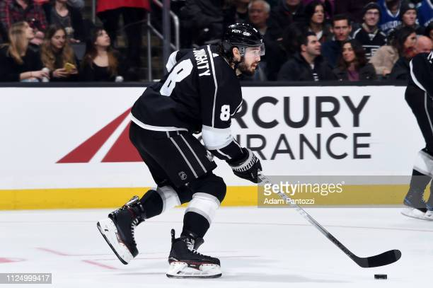 Drew Doughty of the Los Angeles Kings skates with the puck during the second period of the game against the Vancouver Canucks at STAPLES Center on...