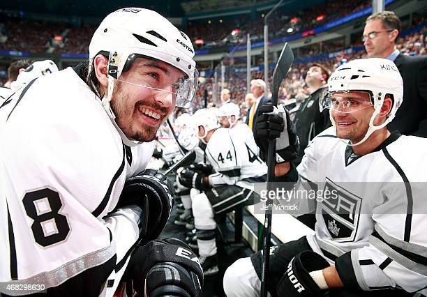 Drew Doughty of the Los Angeles Kings smiles on the bench during their NHL game against the Los Angeles Kings at Rogers Arena March 12 2015 in...