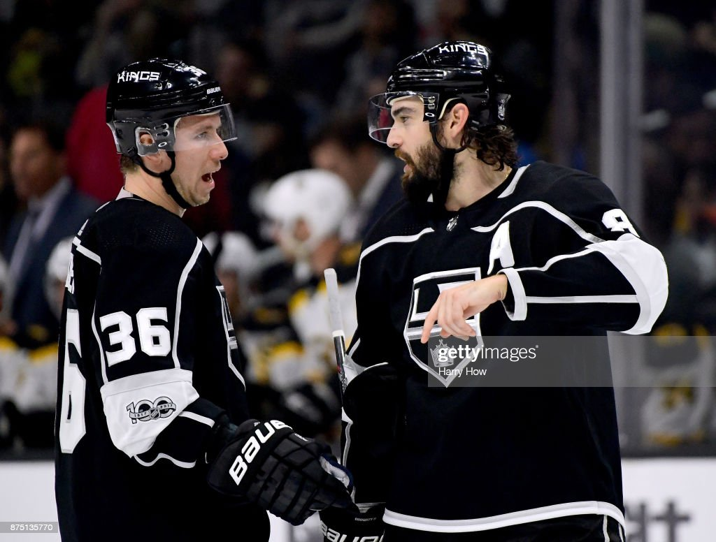 Drew Doughty #8 of the Los Angeles Kings speaks to Jussi Jokinen #36 of the Los Angeles Kings during the first period against the Boston Bruins in his first game as an Los Angeles Kings at Staples Center on November 16, 2017 in Los Angeles, California.