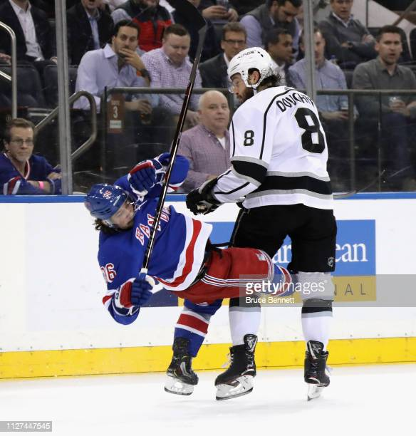 Drew Doughty of the Los Angeles Kings steps into Mats Zuccarello of the New York Rangers during the third period at Madison Square Garden on February...