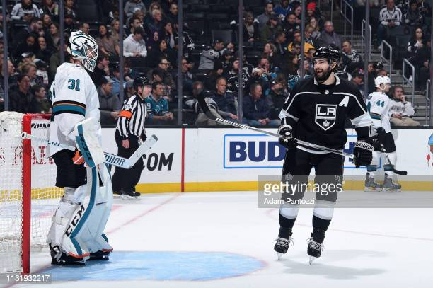 Drew Doughty of the Los Angeles Kings talks with goaltender Martin Jones of the San Jose Sharks during the first period of the game at STAPLES Center...