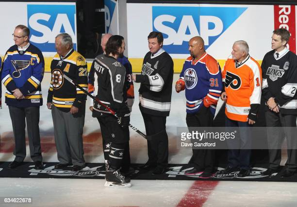 Drew Doughty of the Los Angeles Kings talks with Wayne Gretzky during pregame ceremonies prior to the 2017 Honda NHL AllStar Game at Staples Center...