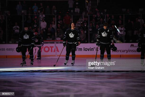Drew Doughty Ryan Smyth and Anze Kopitar of the Los Angeles Kings stand on the ice before the game against the Phoenix Coyotes on September 15 2009...