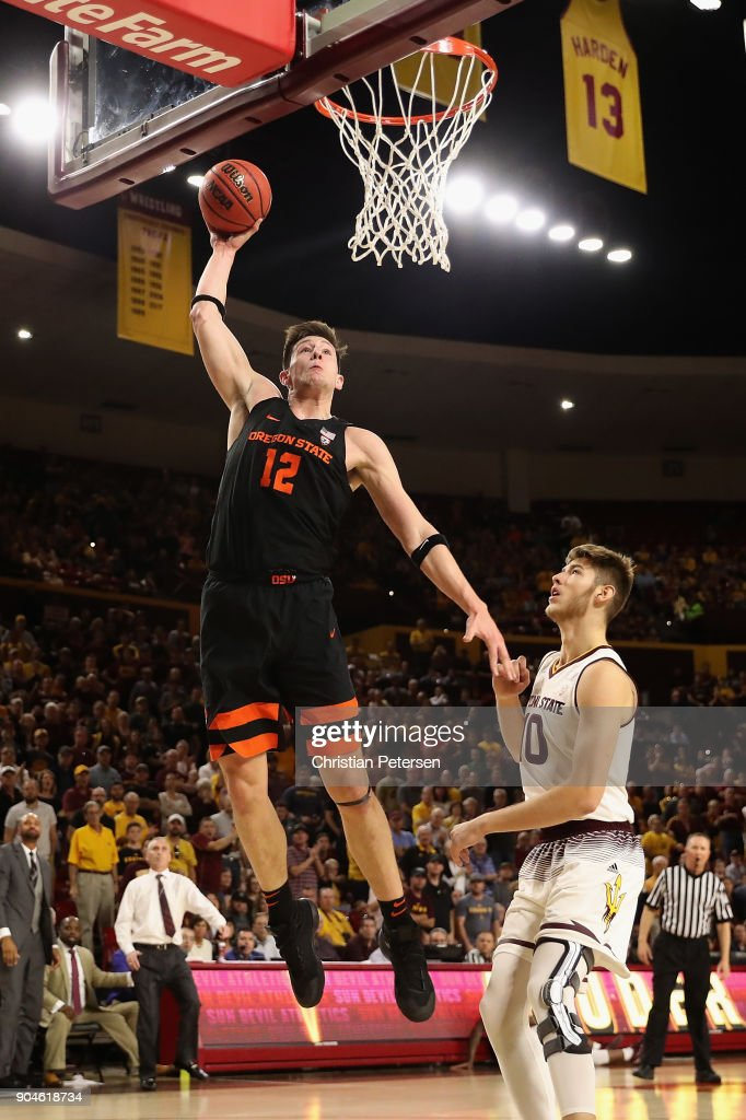 Drew Eubanks #12 of the Oregon State Beavers slam dunks the ball over Vitaliy Shibel #10 of the Arizona State Sun Devils during the first half of the college basketball game at Wells Fargo Arena on January 13, 2018 in Tempe, Arizona.