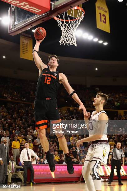 Drew Eubanks of the Oregon State Beavers slam dunks the ball over Vitaliy Shibel of the Arizona State Sun Devils during the first half of the college...