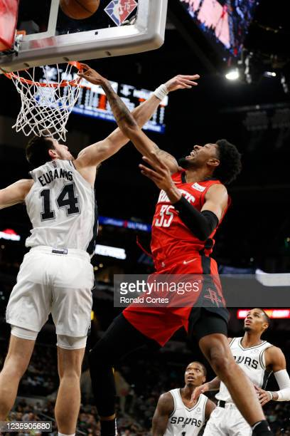Drew Eubanks of the San Antonio Spurs blocks shot of Christian Wood of the Houston Rockets of a pre-season game at AT&T Center on October 2, 2021 in...