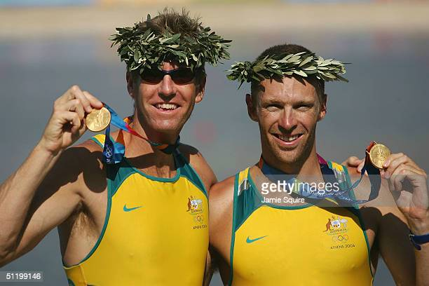 Drew Ginn and James Tomkins of Australia pose with their Gold medals after the men's pair final on August 21 2004 during the Athens 2004 Summer...