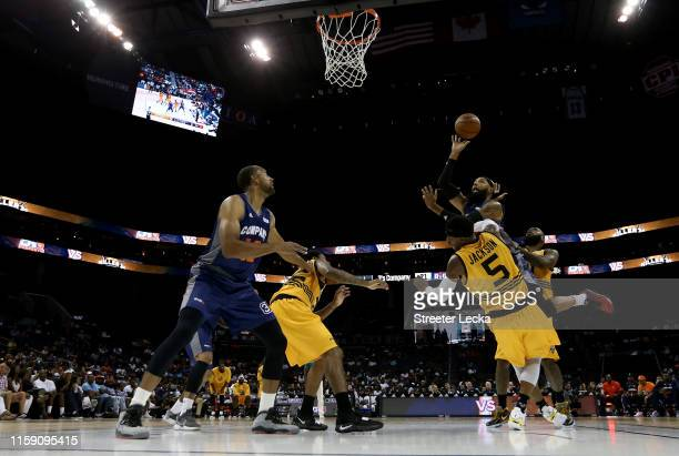 Drew Gooden of 3's Company drives to the basket against Stephen Jackson of Killer 3s during week two of the BIG3 three on three basketball league at...