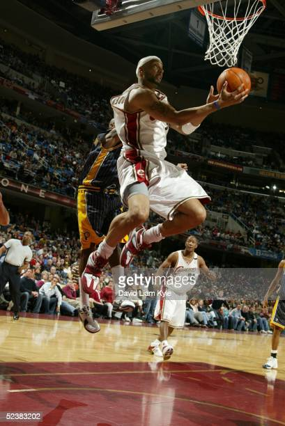 Drew Gooden of the Cleveland Cavaliers drives in for a reverse layup against the Indiana Pacers at Gund Arena on March 13 2005 in Cleveland Ohio NOTE...
