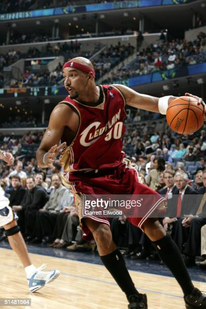 Drew Gooden of the Cleveland Cavaliers drives to the basket against the Memphis Grizzlies on October 14 2004 at the FedEx Forum in Memphis Tennessee...