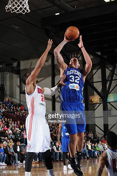 Drew Gordon of the Delaware 87ers shoots over Renaldo Woolridge of the Grand Rapids Drive during the NBA D-League game on January 31, 2015 at the...
