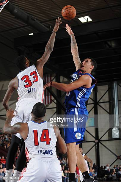 Drew Gordon of the Delaware 87ers shoots over Willie Reed and Adonis Thomas of the Grand Rapids Drive during the NBA D-League game on January 31,...