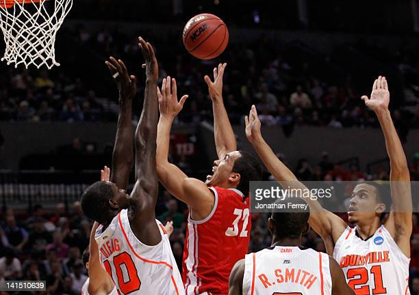 Drew Gordon of the New Mexico Lobos goes up for a shot over Gorgui Dieng of the Louisville Cardinals in the first half during the third round of the...