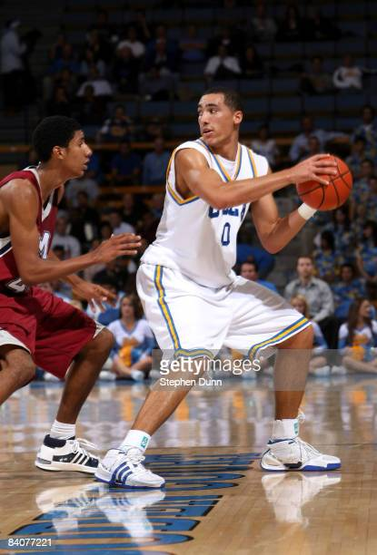 Drew Gordon of the UCLA Bruins controls the ball against Kevin Young of the Loyola Marymount Lions at Pauley Pavilion December 17 2008 in Westwood...