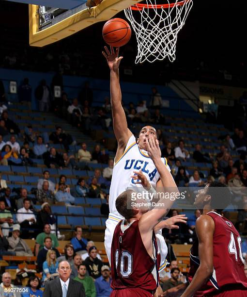 Drew Gordon of the UCLA Bruins shoots over Brad Sweezy of the Loyola Marymount Lions at Pauley Pavilion December 17 2008 in Westwood California UCLA...