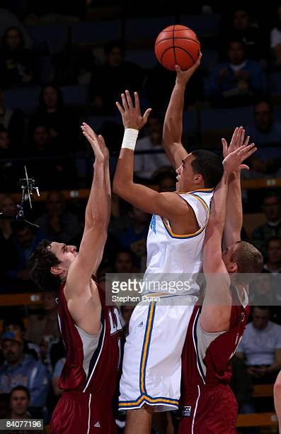 Drew Gordon of the UCLA Bruins shoots over Marko Deric and Brad Sweezy of the Loyola Marymount Lions at Pauley Pavilion December 17 2008 in Westwood...