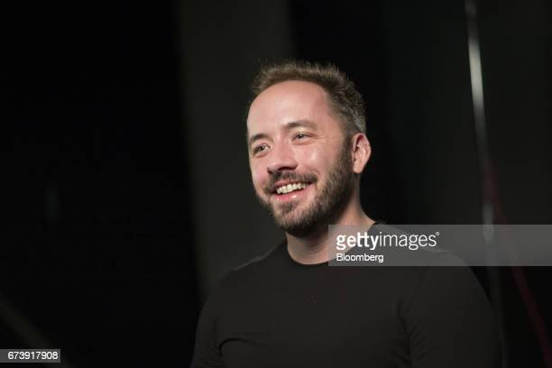 Drew Houston chief executive officer and cofounder of Dropbox Inc smiles during a Bloomberg Technology interview in San Francisco California US on...