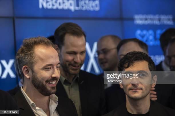 Drew Houston chief executive officer and cofounder of Dropbox Inc left and Arash Ferdowsi cofounder of Dropbox Inc react during the company's initial...