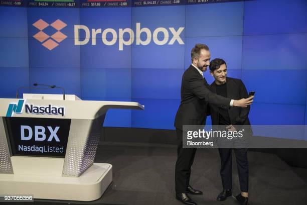 Drew Houston chief executive officer and cofounder of Dropbox Inc left and Arash Ferdowsi cofounder of Dropbox Inc take a selfie photograph during...